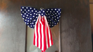 So unAmerican we hung a American Flag bow from our door!